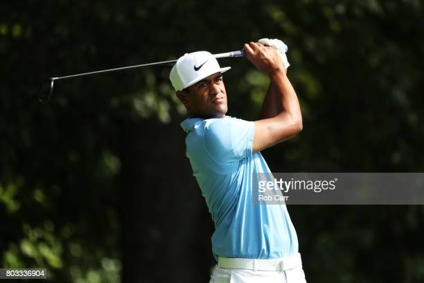 Tony Finau of the United States plays his shot from the eighth tee during the first round of the Quicken Loans National on June 29 2017 TPC Potomac...