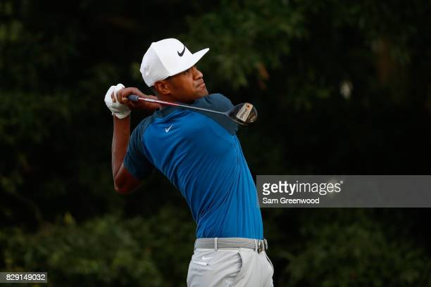 Tony Finau of the United States plays his shot from the second tee during the first round of the 2017 PGA Championship at Quail Hollow Club on August...