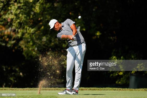Tony Finau of the United States plays his shot from the second tee during the first round of the TOUR Championship at East Lake Golf Club on...