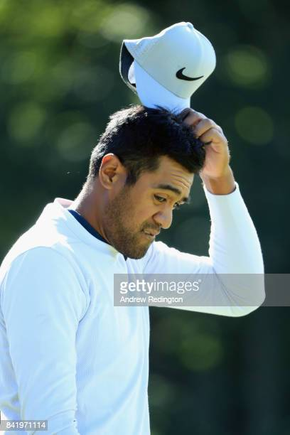 Tony Finau of the United States reacts on the fourth hole during round two of the Dell Technologies Championship at TPC Boston on September 2 2017 in...