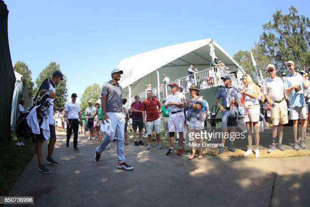 Tony Finau of the United States walks past fans during the first round of the TOUR Championship at East Lake Golf Club on September 21 2017 in...