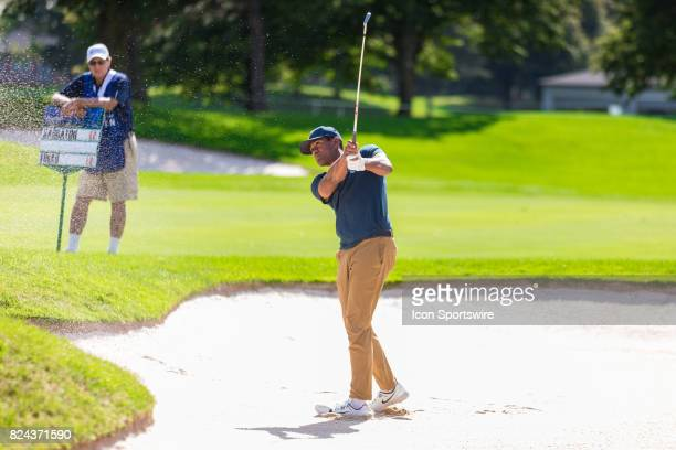 Tony Finau plays a shot out of a sand trap on the 18th hole during third round action of the RBC Canadian Open on July 29 at Glen Abbey Golf Club in...