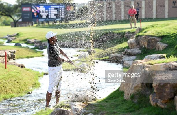 Tony Finau plays his fourth shot out of the water hazard on the 18th hole during the second round of the Valero Texas Open at TPC San Antonio ATT...