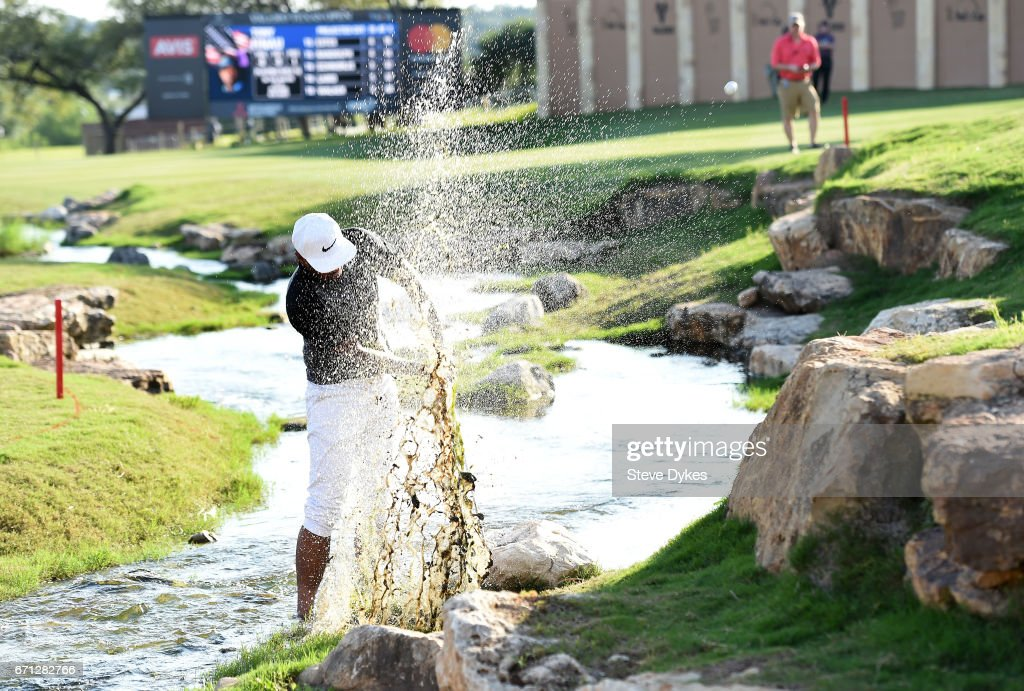 Tony Finau plays his fourth shot out of the water hazard on the 18th hole during the second round of the Valero Texas Open at TPC San Antonio AT&T Oaks Course on April 21, 2017 in San Antonio, Texas.