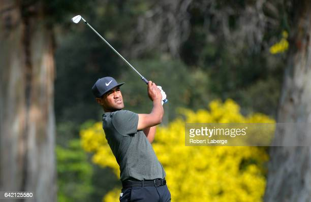 Tony Finau plays his shot on the 13th hole during the first round at the Genesis Open at Riviera Country Club on February 16 2017 in Pacific...