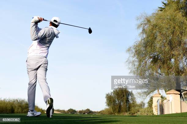 Tony Finau plays his tee shot on the third hole during the first round of the Waste Management Phoenix Open at TPC Scottsdale on February 2 2017 in...