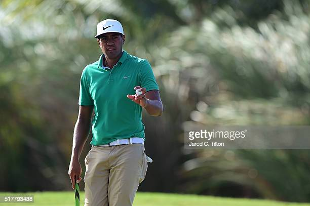 Tony Finau waves to the crowd after making his par putt on the 17th hole during the final round of the Puerto Rico Open at Coco Beach on March 27...