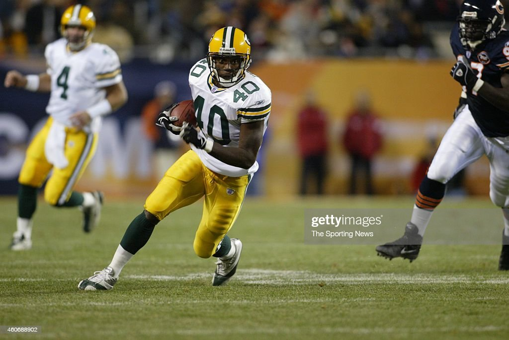 <a gi-track='captionPersonalityLinkClicked' href=/galleries/search?phrase=Tony+Fisher&family=editorial&specificpeople=213031 ng-click='$event.stopPropagation()'>Tony Fisher</a> #40 of the Green Bay Packers runs with the ball during a game against the Chicago Bears on September 29, 2003 at Soldier Field in Chicago, Illinois.