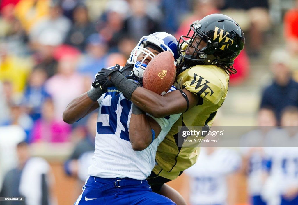 Tony Foster of the Duke Blue Devils breaks up a pass intended for Sherman Raglund III of the Wake Forest Demon Deacons at BBT Field on September 29...