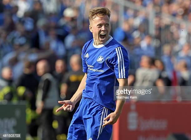Tony Fuchs of Neustrelitz jubilates after scoring the third goal during the Regionalliga Nordost match between TSG Neustrelitz and 1FC Magdeburg at...