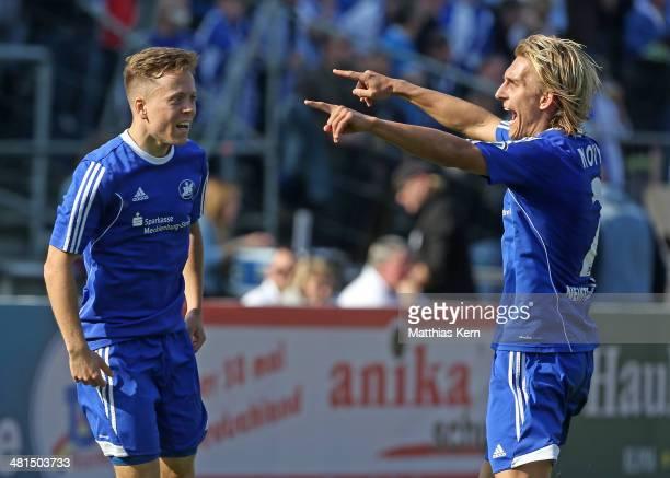 Tony Fuchs of Neustrelitz jubilates with team mate Lukas Novy after scoring the third goal during the Regionalliga Nordost match between TSG...
