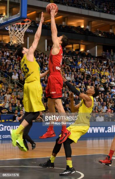 Tony Gaffney of Alba Berlin Vladimir Lucic of FC Bayern Muenchen and Malcolm Miller of Alba Berlin during the easyCredit BBL match between Alba...