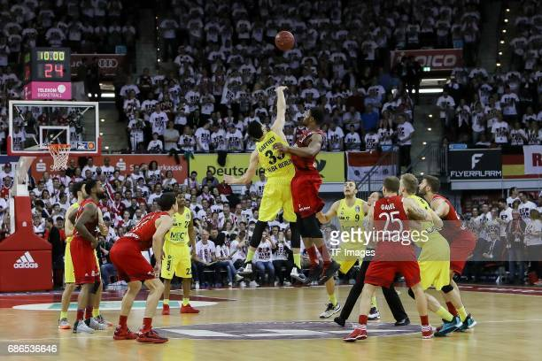Tony Gaffney of Berlin und Devin Booker of Munich battle for the ball during the easyCredit BBL Basketball Bundesliga match between FC Bayern Muenche...