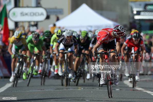 Tony Gallopin of France and Lotto Belisol looks back as the peloton closes in on his solo breakaway in the final meters as he held on to win the...