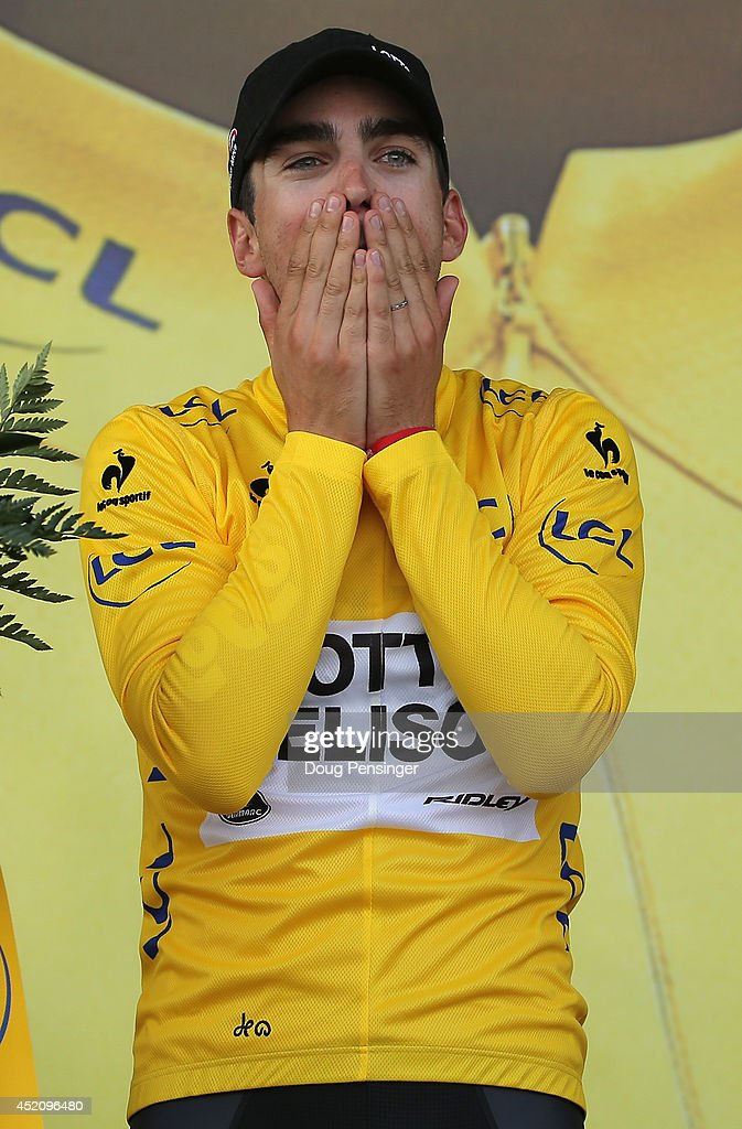 <a gi-track='captionPersonalityLinkClicked' href=/galleries/search?phrase=Tony+Gallopin&family=editorial&specificpeople=6712360 ng-click='$event.stopPropagation()'>Tony Gallopin</a> of France and Lotto Belisol takes the podium after claiming the overall race leader's jersey in stage nine of the 2014 Le Tour de France from Gerardmer to Mulhouse on July 13, 2014 in Mulhouse, France.