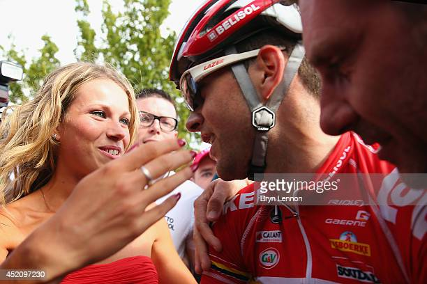 Tony Gallopin of France and Team Lotto Belisol kissing his girlfriend Marion Rousse after securing the yellow jersey and race lead on the ninth stage...