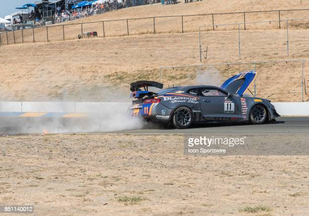 Tony Gaples Blackdog Speed Shop skids across the track after impacting the West Kwall off of turn 8 in his wrecked Chevrolet Camaro GT4 during the...