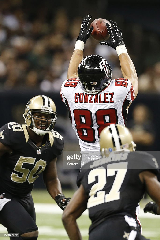 <a gi-track='captionPersonalityLinkClicked' href=/galleries/search?phrase=Tony+Gonzalez&family=editorial&specificpeople=203240 ng-click='$event.stopPropagation()'>Tony Gonzalez</a> #88 of the Atlanta Falcons catches a pass between <a gi-track='captionPersonalityLinkClicked' href=/galleries/search?phrase=Malcolm+Jenkins&family=editorial&specificpeople=2726916 ng-click='$event.stopPropagation()'>Malcolm Jenkins</a> #27 and <a gi-track='captionPersonalityLinkClicked' href=/galleries/search?phrase=Curtis+Lofton&family=editorial&specificpeople=4060659 ng-click='$event.stopPropagation()'>Curtis Lofton</a> #50 of the New Orleans Saints at Mercedes-Benz Superdome on November 11, 2012 in New Orleans, Louisiana. The Saints defeated the Falcons 31-27.