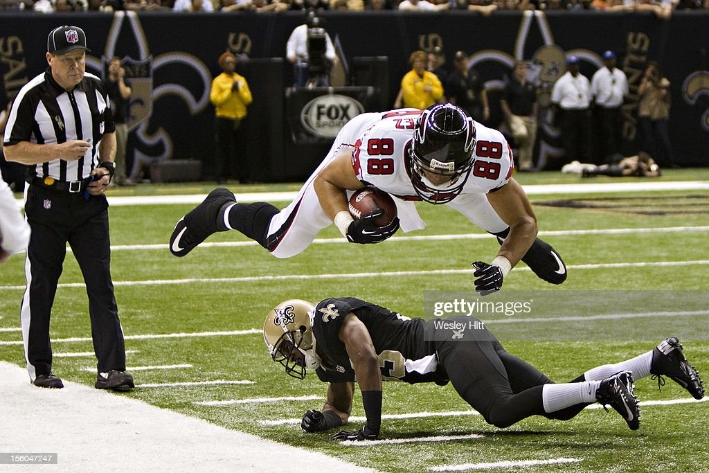 <a gi-track='captionPersonalityLinkClicked' href=/galleries/search?phrase=Tony+Gonzalez&family=editorial&specificpeople=203240 ng-click='$event.stopPropagation()'>Tony Gonzalez</a> #88 of the Atlanta Falcons dives over <a gi-track='captionPersonalityLinkClicked' href=/galleries/search?phrase=Jabari+Greer&family=editorial&specificpeople=2112639 ng-click='$event.stopPropagation()'>Jabari Greer</a> #33 of the New Orleans Saints at Mercedes-Benz Superdome on November 11, 2012 in New Orleans, Louisiana. The Saints defeated the Falcons 31-27
