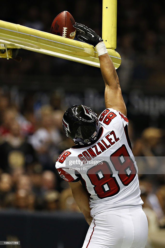 <a gi-track='captionPersonalityLinkClicked' href=/galleries/search?phrase=Tony+Gonzalez&family=editorial&specificpeople=203240 ng-click='$event.stopPropagation()'>Tony Gonzalez</a> #88 of the Atlanta Falcons dunks the football over the goal post after scoring a touchdown against the New Orleans Saints at Mercedes-Benz Superdome on November 11, 2012 in New Orleans, Louisiana. The Saints defeated the Falcons 31-27.