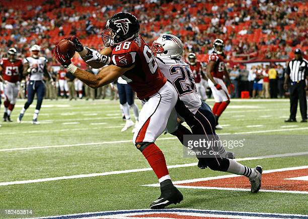 Tony Gonzalez of the Atlanta Falcons pulls in this touchdown reception against Logan Ryan of the New England Patriots at Georgia Dome on September 29...