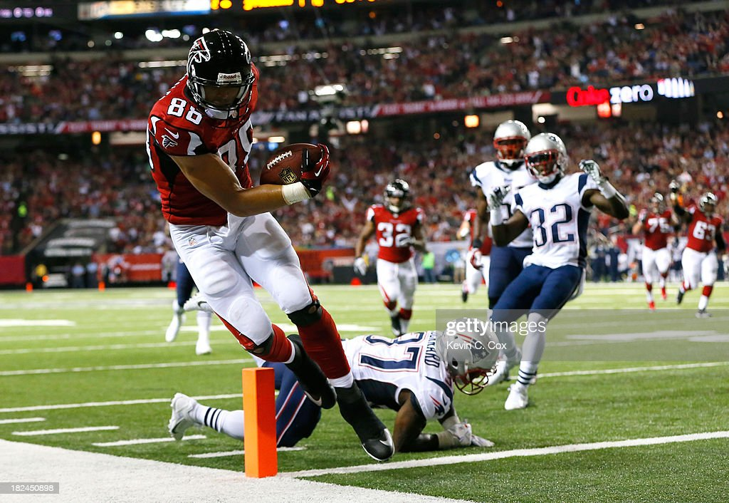 Tony Gonzalez #88 of the Atlanta Falcons scores a touchdown past Alfonzo Dennard #37 of the New England Patriots at Georgia Dome on September 29, 2013 in Atlanta, Georgia.