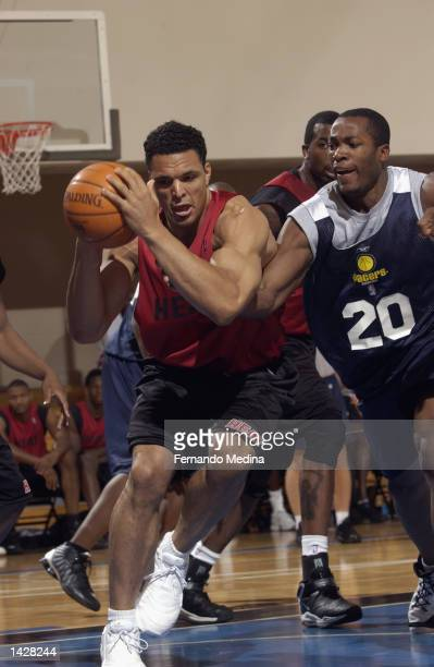 Tony Gonzalez of the Miami Heat is defended by Fred Jones of the Indiana Pacers during the Orlando Pro Summer League on July 10 2002 at RDV...