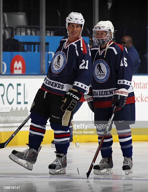 Tony Granato and Shelley Looney of the USA Legends skate in warmups prior to playing against the Canada Legends at the Legends Classic Hockey Game at...