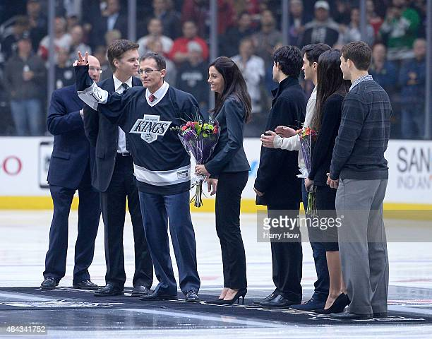 Tony Granato waves to the crowd as he is honored on Legends Night at center ice before the game between the Detroit Red Wings and the Los Angeles...