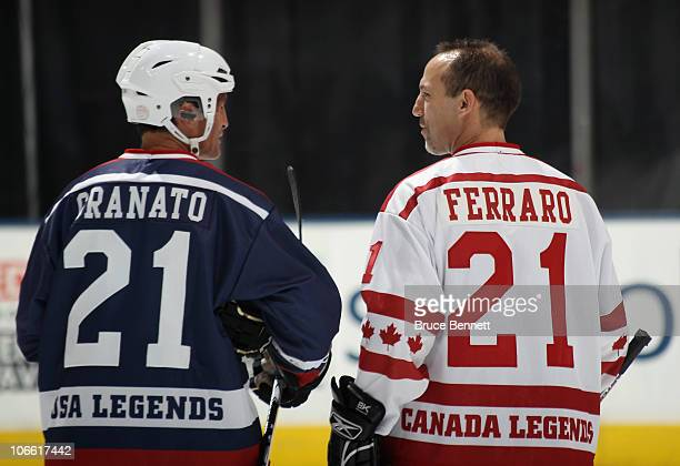 Tony Granato#21 of the USA Legends and Ray Ferraro of the Canada Legends skate in warmups prior to the Legends Classic Hockey Game at the Air Canada...