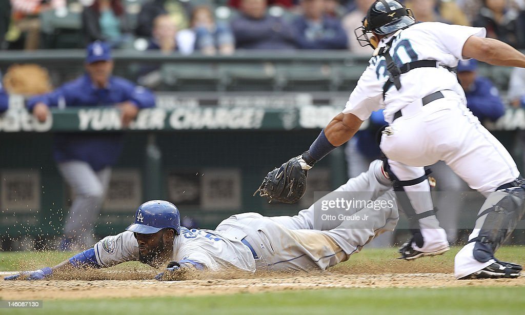 Tony Gwynn Jr. #10 of the Los Angeles Dodgers scores on a fielders choice by Elian Herrera in the ninth inning against catcher <a gi-track='captionPersonalityLinkClicked' href=/galleries/search?phrase=Miguel+Olivo&family=editorial&specificpeople=209185 ng-click='$event.stopPropagation()'>Miguel Olivo</a> #30 of the Seattle Mariners at Safeco Field on June 9, 2012 in Seattle, Washington.