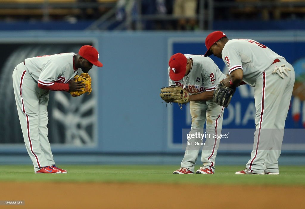 <a gi-track='captionPersonalityLinkClicked' href=/galleries/search?phrase=Tony+Gwynn+Jr.&family=editorial&specificpeople=206941 ng-click='$event.stopPropagation()'>Tony Gwynn Jr.</a> #19, <a gi-track='captionPersonalityLinkClicked' href=/galleries/search?phrase=Ben+Revere&family=editorial&specificpeople=6826641 ng-click='$event.stopPropagation()'>Ben Revere</a> #2 and <a gi-track='captionPersonalityLinkClicked' href=/galleries/search?phrase=Marlon+Byrd&family=editorial&specificpeople=217377 ng-click='$event.stopPropagation()'>Marlon Byrd</a> #3 of the Philadelphia Phillies celebrate the Phillies' 7-3 victory over the Los Angeles Dodgers at Dodger Stadium on April 24, 2014 in Los Angeles, California.