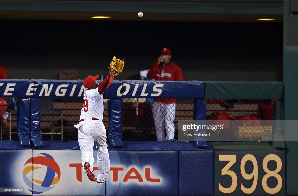 Tony Gwynn Jr. #19 of the Philadelphia Phillies can't catch the ball, which resulted in a double by Adeiny Hechavarria #3 of the Miami Marlins in the second inning at Citizens Bank Park on April 11, 2014 in Philadelphia, Pennsylvania.