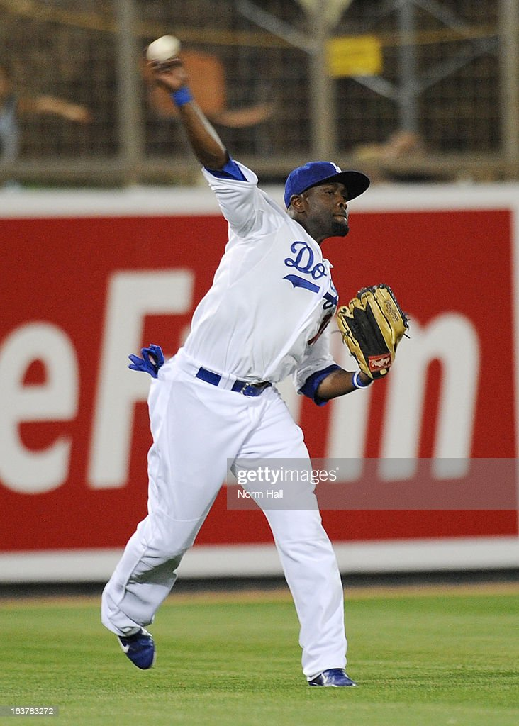 Tony Gwynn Jr #10 of the Los Angeles Dodgers throws the ball to the infield against the Kansas City Royals on March 15, 2013 in Glendale, Arizona.