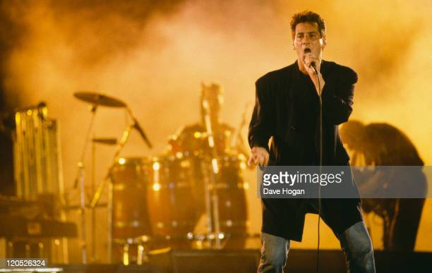 Tony Hadley performing on stage with British pop group Spandau Ballet circa 1985