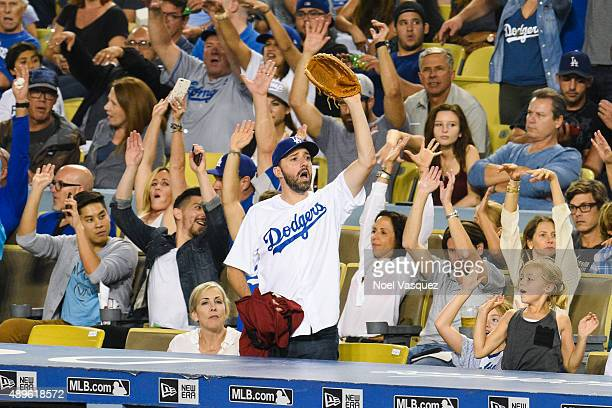 Tony Hale does the wave at a baseball game between the Arizona Diamondback and the Los Angeles Dodgers at Dodger Stadium on September 22 2015 in Los...