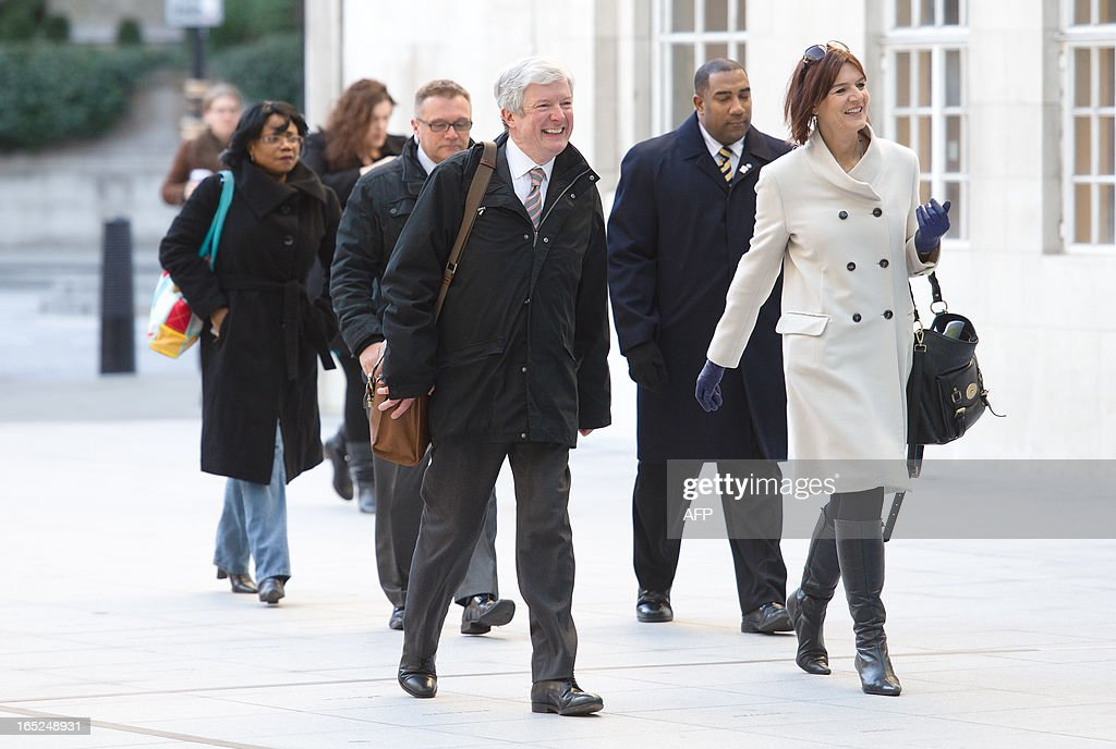 Tony Hall (front L) smiles as he arrives for his first day as Director General of the BBC at New Broadcasting House in central London on April 2, 2013. Having previously worked as Chief Executive at the Royal Opera House, the new BBC chief must now deal with the fallout from allegations that the late BBC star Jimmy Savile was a serial child sex offender. AFP PHOTO / LEON NEAL