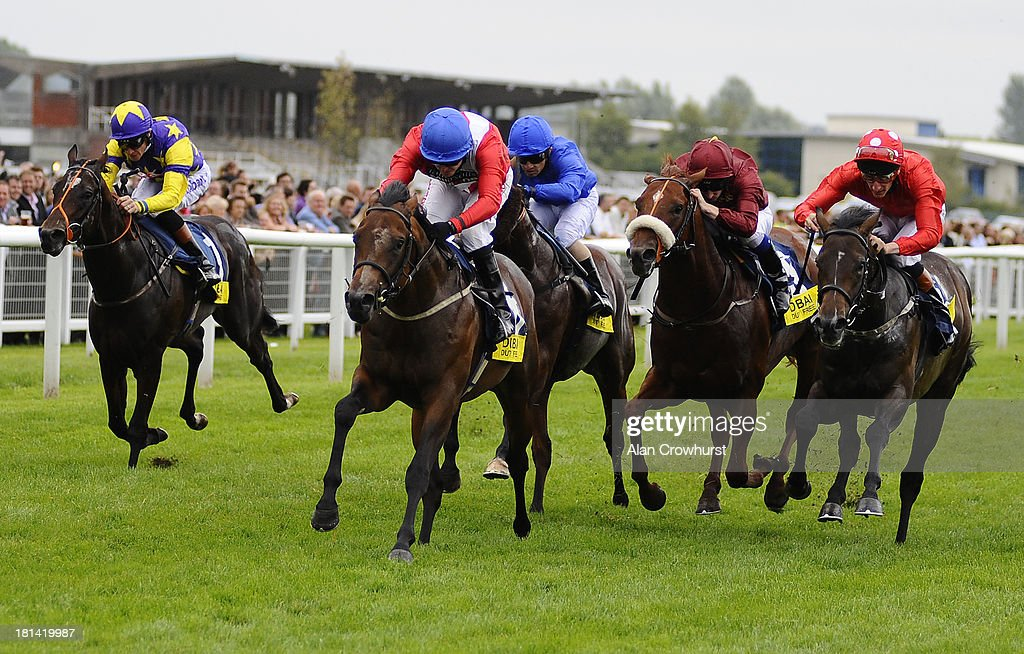 Tony Hamilton riding Supplicant win the Dubai Duty Free Mill Reef Stakes at Newbury racecourse on September 21, 2013 in Newbury, England.