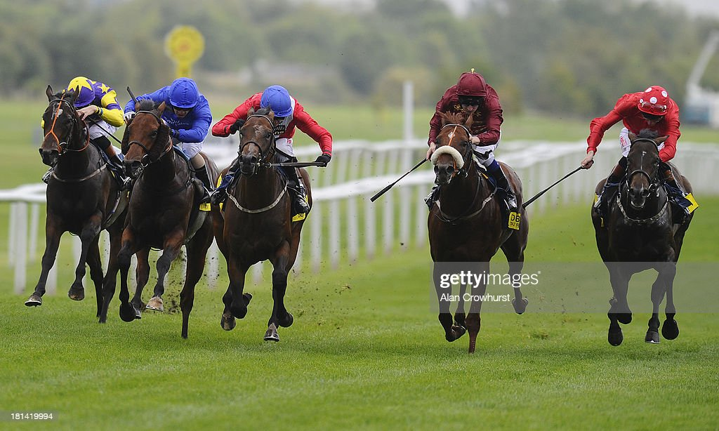 Tony Hamilton riding Supplicant (3L) wins the Dubai Duty Free Mill Reef Stakes at Newbury racecourse on September 21, 2013 in Newbury, England.