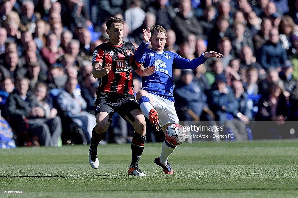 Tony Hibbert of Everton challenges Marc Pugh during the Barclays Premier League match between Everton and A.F.C. Bournemouth at Goodison Park on April 30, 2016 in Liverpool, England.
