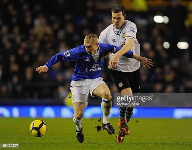 Tony Hibbert of Everton holds off Kevin McDonald of Burnley during the Barclays Premier League match between Everton and Burnley at Goodison Park on...