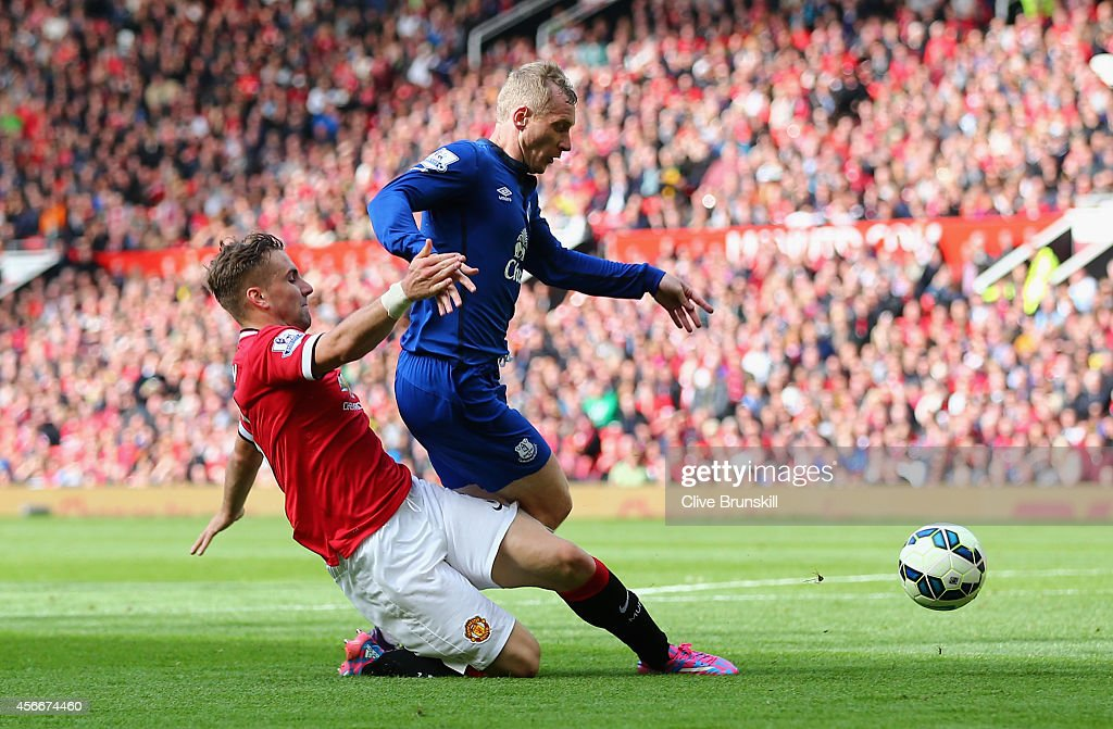 Tony Hibbert of Everton is fouled in the penalty box by Luke Shaw of Manchester United during the Barclays Premier League match between Manchester United and Everton at Old Trafford on October 5, 2014 in Manchester, England.