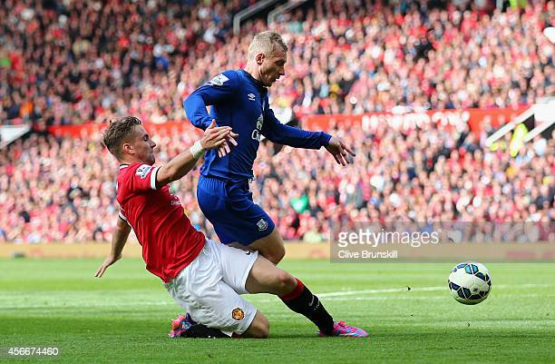 Tony Hibbert of Everton is fouled in the penalty box by Luke Shaw of Manchester United during the Barclays Premier League match between Manchester...