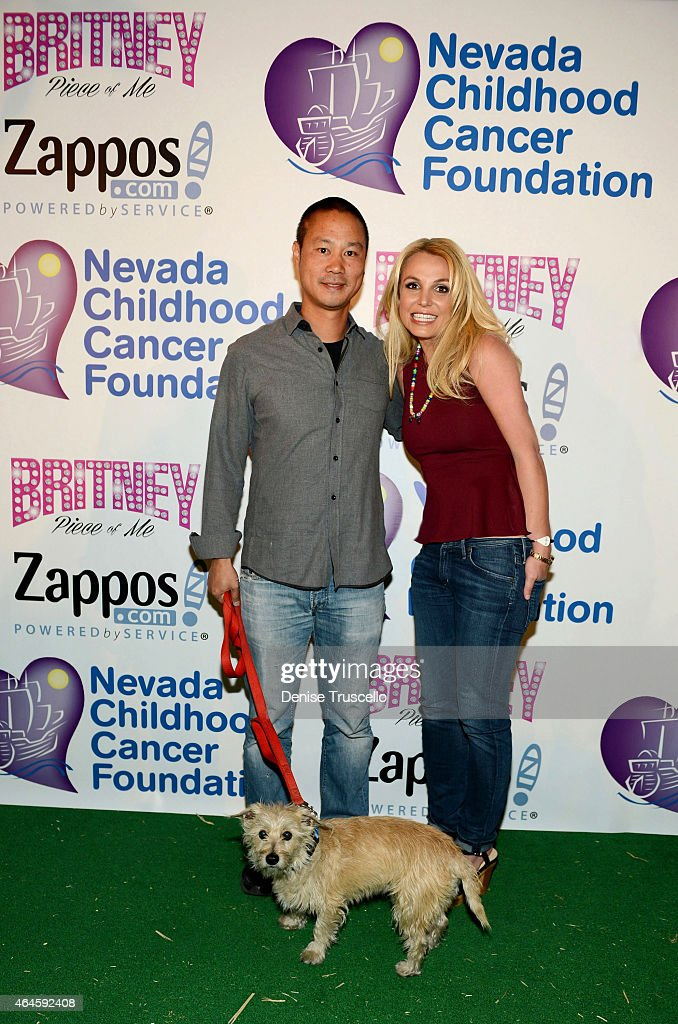 Tony Hsieh (L) poses for a photo with Britney Spears (R) who visited the Zappos.com campus in Downtown Las Vegas to celebrate her partnership with the Nevada Childhood Cancer Foundation (NCCF) and Zappos on February 26, 2015 in Las Vegas, Nevada. Britney met with children and played with animals from the Roos-n-More Zoo. All funds raised aredonated in support of the NCCF.