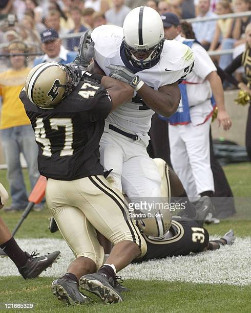 Tony Hunt bowls over Landon Johnson in the second quarter for a touchdown in Purdue's 2814 win over Penn State Oct 11 2003 in W Lafayette IN