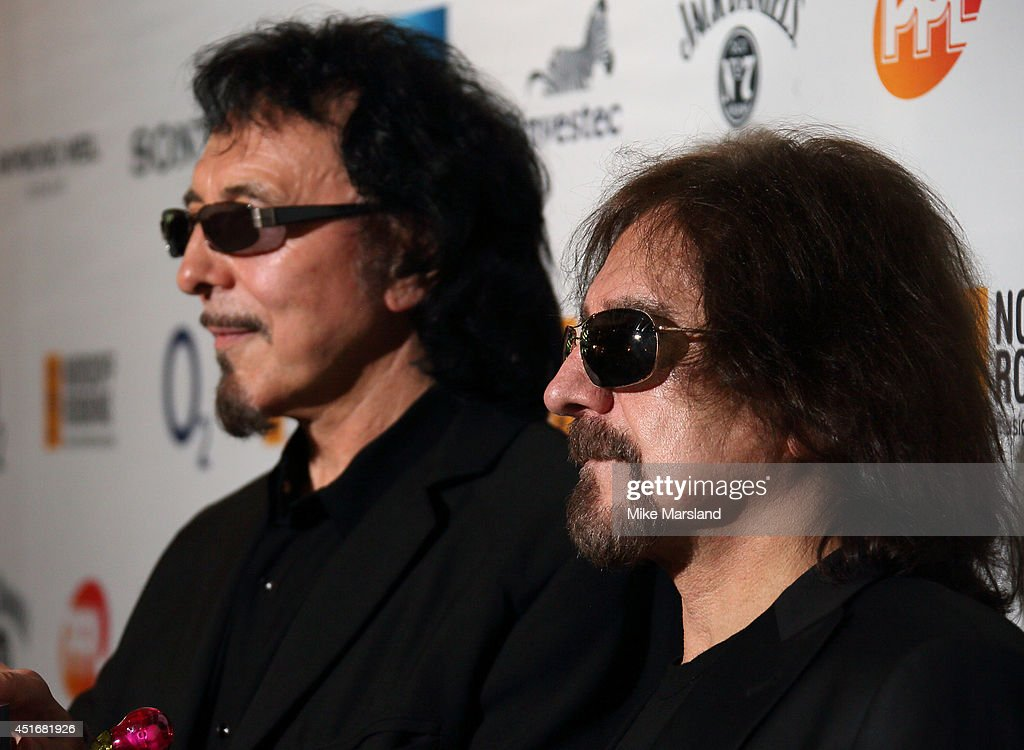<a gi-track='captionPersonalityLinkClicked' href=/galleries/search?phrase=Tony+Iommi&family=editorial&specificpeople=810317 ng-click='$event.stopPropagation()'>Tony Iommi</a> and <a gi-track='captionPersonalityLinkClicked' href=/galleries/search?phrase=Geezer+Butler&family=editorial&specificpeople=810495 ng-click='$event.stopPropagation()'>Geezer Butler</a> attend the Nordoff Robbins 02 Silver Clef awards at London Hilton on July 4, 2014 in London, England.