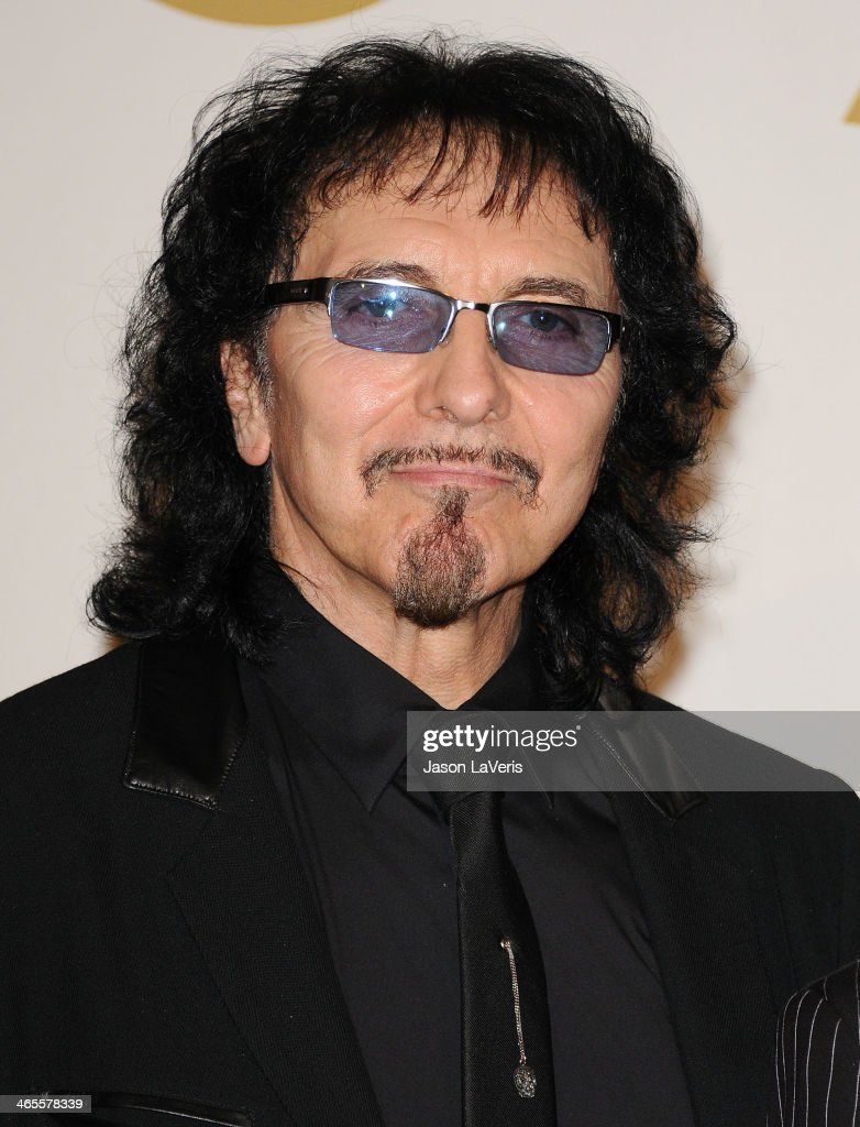 Tony Iommi of Black Sabbath poses in the press room at the 56th GRAMMY Awards at Staples Center on January 26, 2014 in Los Angeles, California.