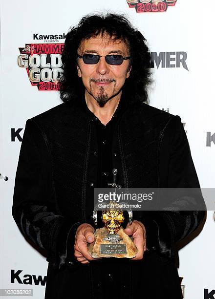 Tony Iommi poses with the Best Album Award at The Metal Hammer Golden Gods Awards at indigo O2 on June 14 2010 in London England