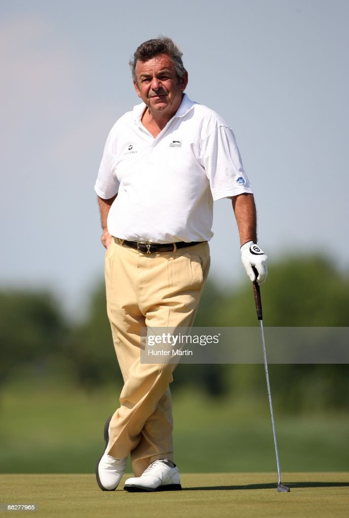 Tony Jacklin of England stands on the 18th green during the first round of the Liberty Mutual Legends of Golf at the Westin Savannah Harbor Golf...