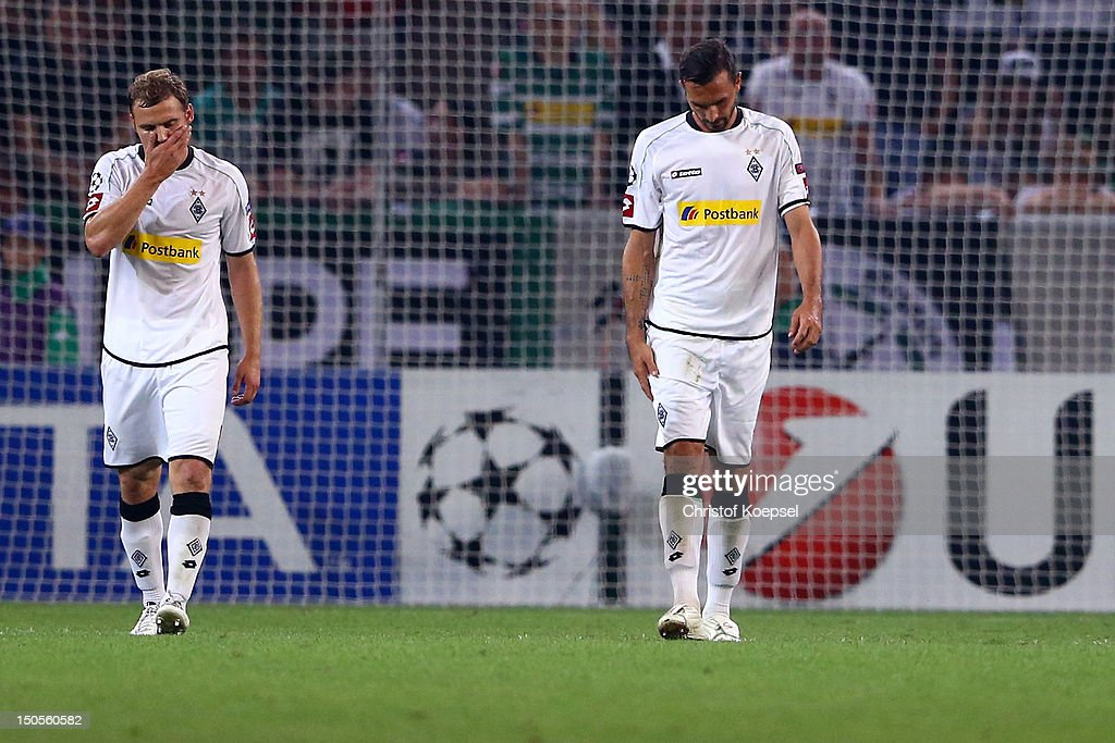 Tony Jantschke and Martin Stranzl of Moenchengladbach look dejected after the third goal of Kiew during the UEFA Champions League playoff first leg...